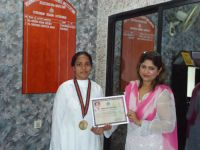 Sister receiving gold medal